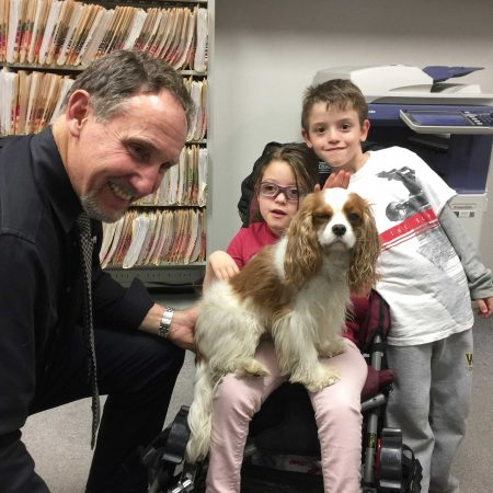 Dr With Client And Dog